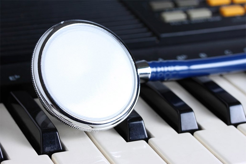 Stethoscope on keyboard ,music therapy